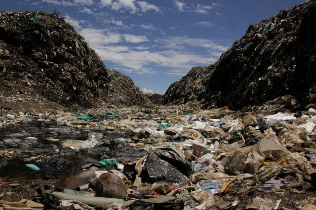 dumping ground with municipal waste polluting the planet and leaving aside unused resources