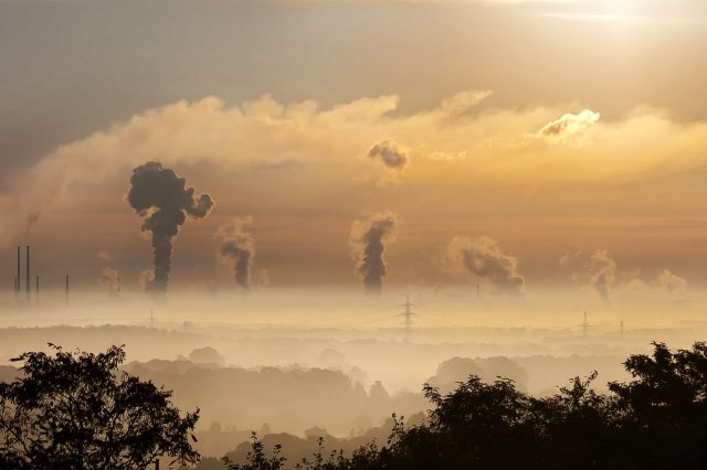 industry exhaust gasses emitting CO2 | carbon dioxide gases into the atmosphere contributing to climate change